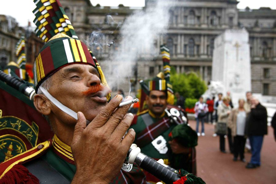 Mohammad Bashir of Patiala Pipe Band enjoys a cigarette in George Square at the launch of Piping Live