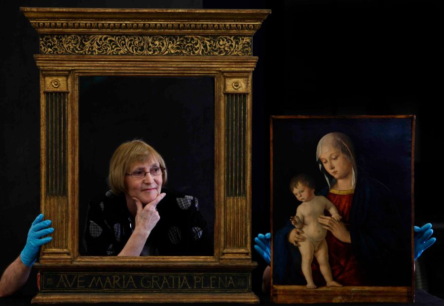Liz Dent of the Fiends of Glasgow Museums with the new frame the group has supplied for the Giovanni Bellini's The Madonna with the Child's Blessing at the Glasgow Museum's Resource Centre.