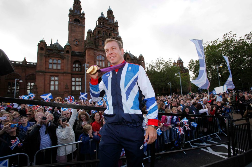 Chris Hoy boards the truck at the Kelvingrove Art Gallery and Museum for the Olympic Homecoming Parade through Glasgow.