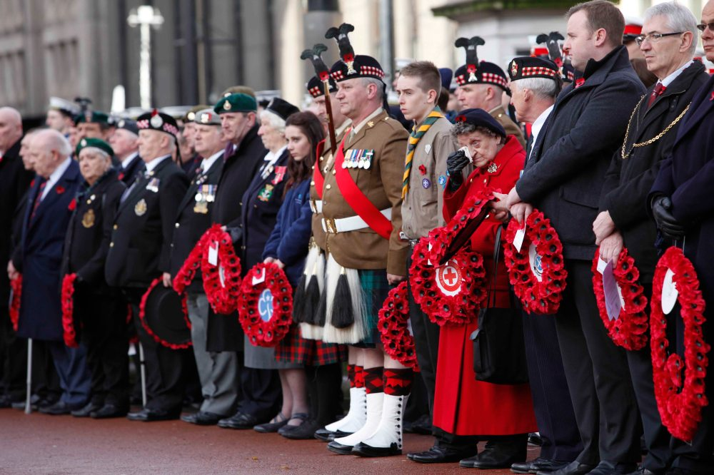 Margaret Nelson (72) from Riddrie , 35 years inj the Red Cross feels the emotion of the  remembrance service  in Glasgow  at George Square