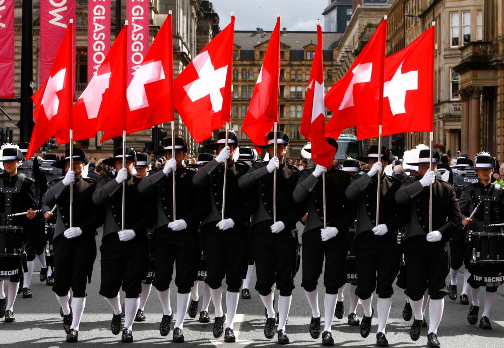 The Edinburgh Military Tattoo parade in George Square , Glasgow. Pictured Switzerland's amazing Top Secret Drum Corps in George Square. Photograph by Martin Shields Herald & Times Ltd