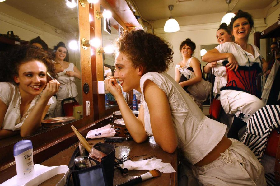 Dancers from Scottish Opera's new production of La Traviata get ready in the dressing room of the Theatre Royal in Glasgow for the dress rehearsal in advance of the opening night performance on 30th Oct Putting on make up is Sophia McGregor watched by l to r Nicki Munro , Jenna Sloan and Jo Jeffries and Jenna Sloan